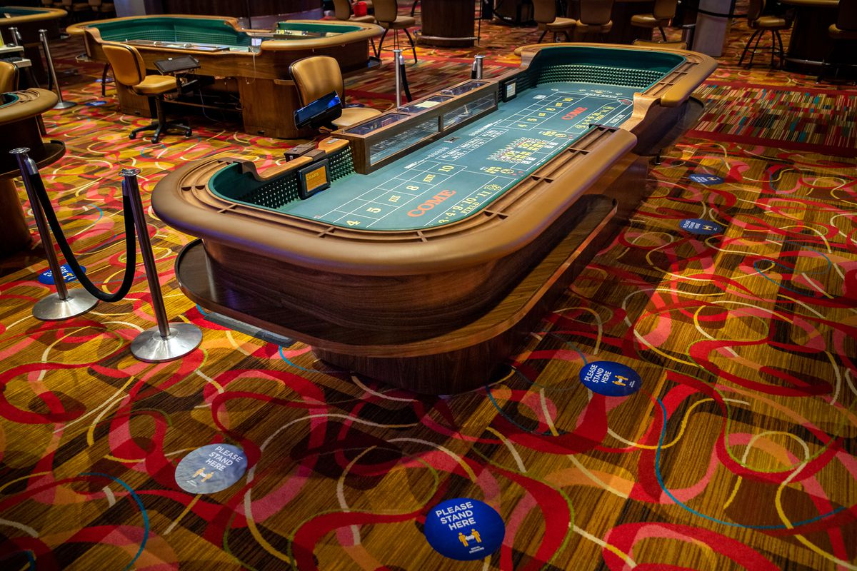Social distancing markers are placed around a craps table at Rivers Casino in Des Plaines.