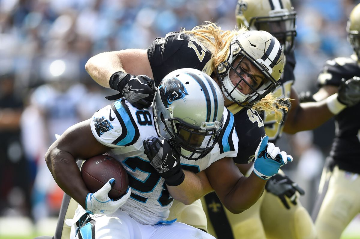 Charlotte, NC, USA; Carolina Panthers running back Jonathan Stewart (28)  is tackled by New Orleans Saints outside linebacker Alex Anzalone (47)  in the fourth quarter at Bank of America Stadium.