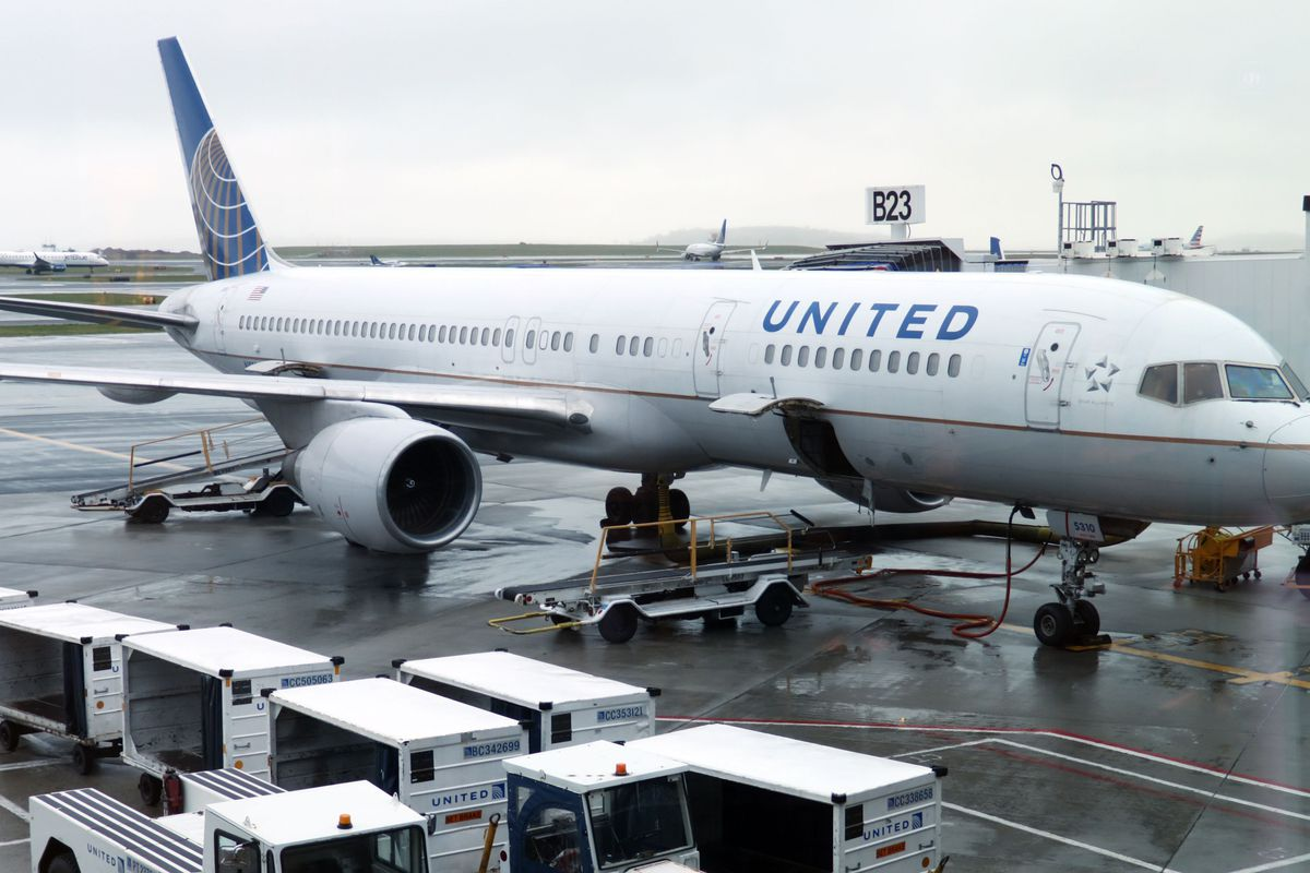 """(FILES) In this file photo taken on April 23, 2019 a United Airlines plane is parked at the gate at Boston Logan International Airport. - United Airlines will keep the Boeing 737 MAX out of service for even longer, and does not expect to fly the plane this summer, executives said on January 22, 2020. The additional delay follows Boeing's announcement January 21, 2020 postponing until mid-2020 the target date for winning approval from regulators to return the MAX to the skies.""""We do not anticipate flying the MAX this summer,"""" United Executive Vice President Andrew Nocella said on a conference call to discuss the airline's earnings. (Photo by Daniel SLIM / AFP) (Photo by DANIEL SLIM/AFP via Getty Images)"""