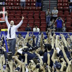 Utah State's head coach Craig Smith cuts down the net following victory over San Diego State for the Mountain West Conference championship Saturday, March 7, 2020, in Las Vegas. Smith was named head coach of the Runnin' Utes on March 27, 2021, replacing Larry Krystkowiak.
