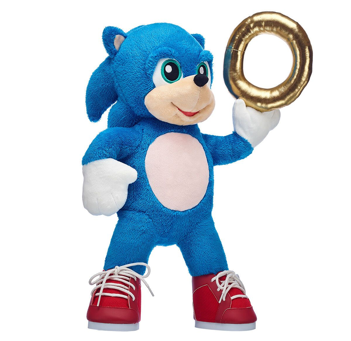 A Sonic the Hedgehog stuff animal holding a gold ring and wearing red shoes