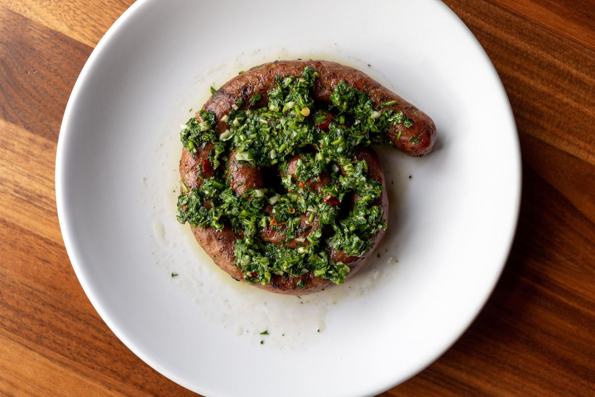 Chorizo Argentino with fennel and lemon centered on a plate