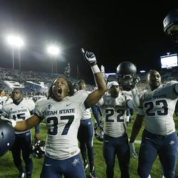 Utah State Aggies celebrate their win over Brigham Young Cougars in Provo Saturday, Oct. 4, 2014. USU won 35-20.