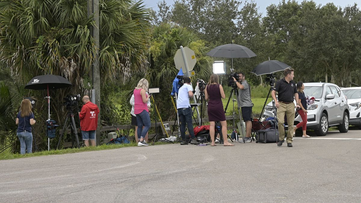 Vehicles line a road outside the entrance of the Carlton Reserve during a search for Brian Laundrie in Venice, Fla.