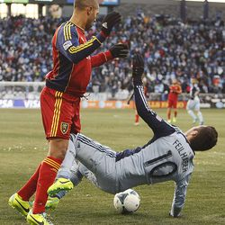 Real's Alvaro Saborio and Kansas City's Benny Feilhaber tangle as Real Salt Lake and Sporting KC play Saturday, Dec. 7, 2013 in MLS Cup action.