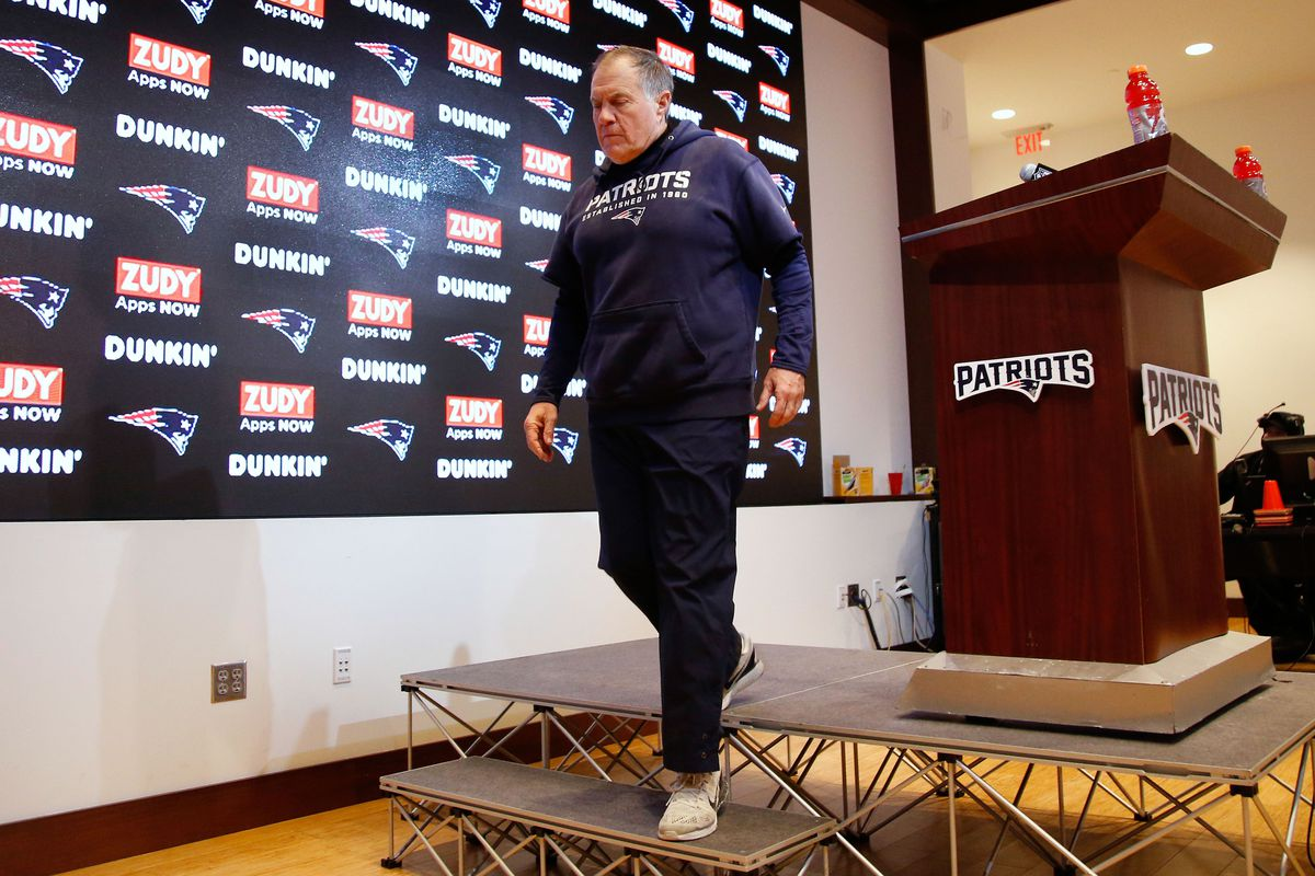 New England Patriots head coach Bill Belichick leaves his press conference following their playoff loss to the Tennessee Titans at Gillette Stadium.