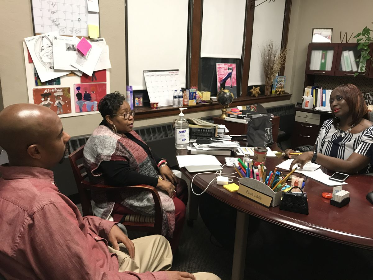 Social studies teacher Stephen Reynolds meets with his school's principal and an academic administrator to discuss ways to incorporate more writing in social studies to help students prepare for a high-stakes exam at Bethune Elementary-Middle School in Detroit.