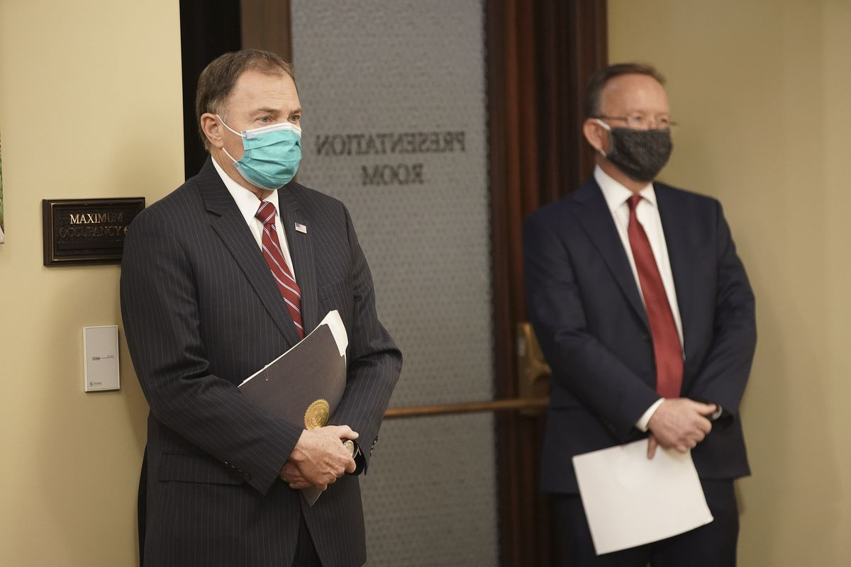 Gov. Gary R. Herbert and Senate President Stuart Adams, R-Layton, listen to speakers during a press conference at the Capitol in Salt Lake City on Friday, April 17, 2020, where legislative, community, business and religious leaders announced plans to reactivate Utah's economy amid the coronavirus pandemic.