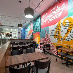 The dining room of Made Nice has a mural by artist Shepard Fairey and is designed by firm Stonehill & Taylor