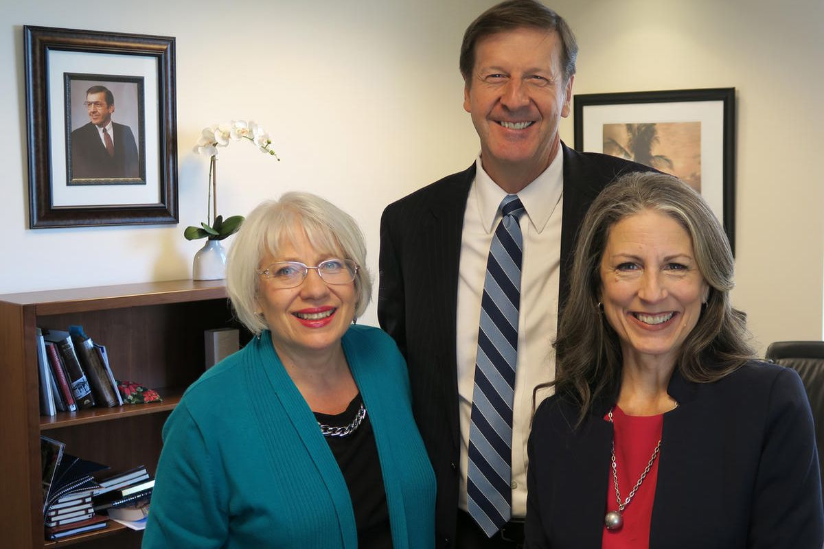 Stephen Rockwood, president of FamilySearch, with Alison Taylor, right, and Joanne Milner, left.