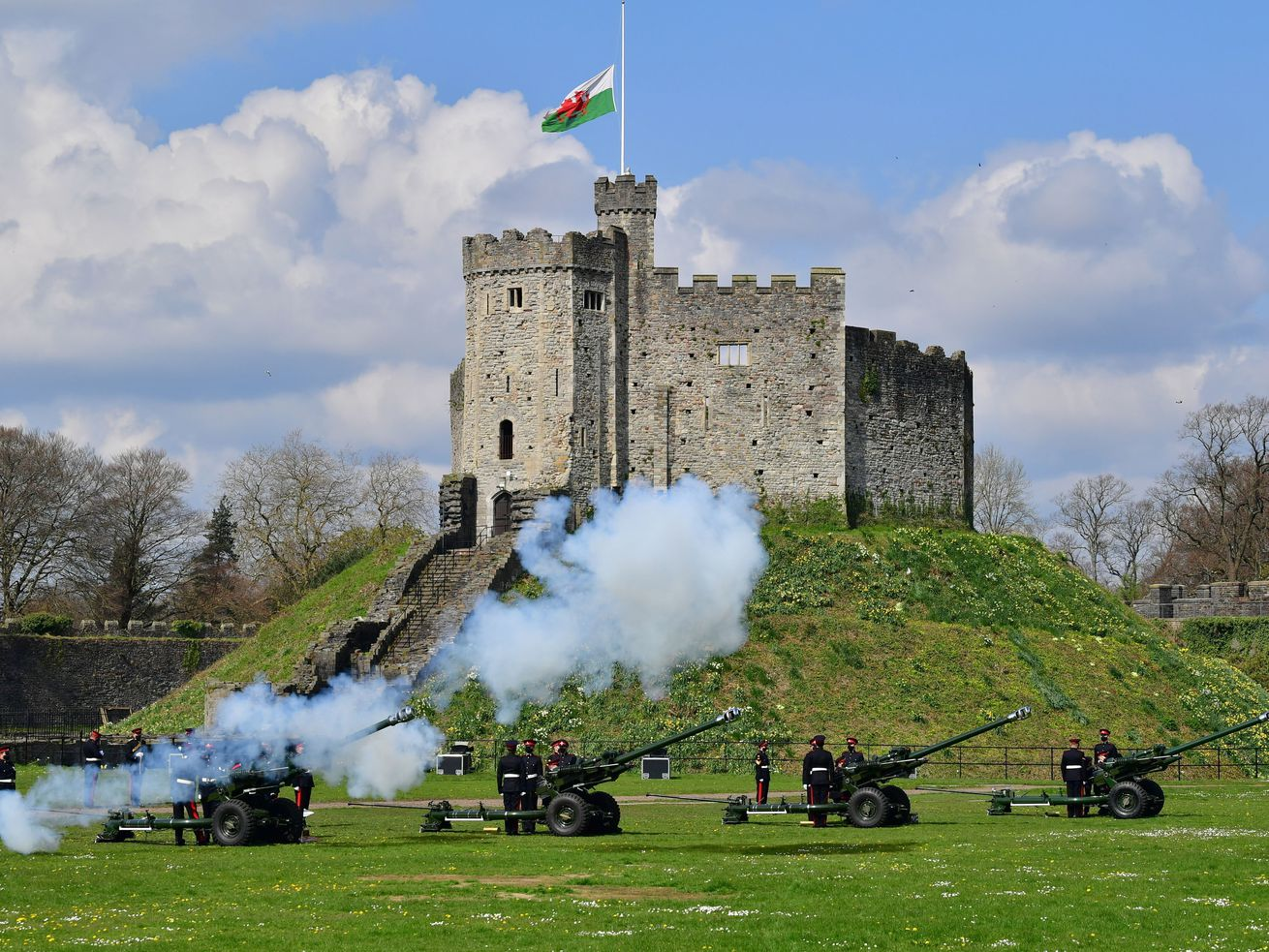 Members of the 104th Regiment Royal Artillery fire a 41-round gun salute in the grounds of Cardiff Castle, to mark the death of Prince Philip, in Cardiff, Saturday, April 10, 2021.