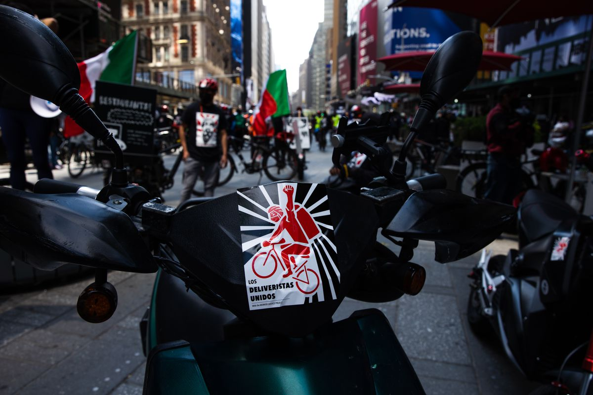 Demonstrators March For Food Delivery Workers Rights