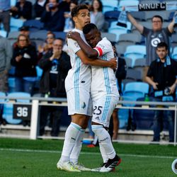 June 12, 2019 - Saint Paul, Minnesota, United States - Minnesota United forward Darwin Quintero (25) and Minnesota United midfielder Hassani Dotson (31) embrace after Quintero scored a goal during the US Open Cup match between Minnesota United and Sporting KC at Allianz Field.