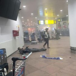 In this photo provided by Georgian Public Broadcaster and photographed by Ketevan Kardava a man is wounded in Brussels Airport in Brussels, Belgium, after explosions were heard Tuesday, March 22, 2016. A developing situation left a number dead in explosions that ripped through the departure hall at Brussels airport Tuesday, police said. All flights were canceled, arriving planes were being diverted and Belgium's terror alert level was raised to maximum, officials said.