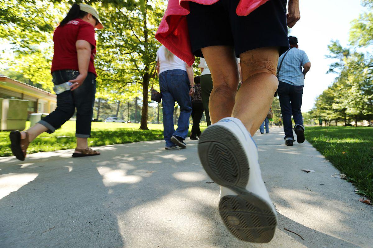 FILE - Seniors walk during the Falls Prevention Awareness Walk at Liberty Park in Salt Lake City Wednesday, Sept. 23, 2015.