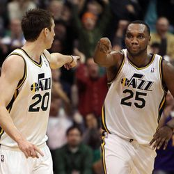 Gordon Hayward, left, and Al Jefferson of the Utah Jazz celebrate as Hayward hits a three pointer near the end of the game against Dallas during NBA basketball in Salt Lake City, Monday, Jan. 7, 2013.