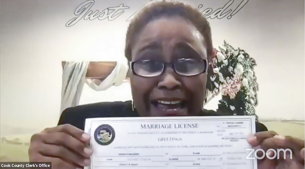 Cook County Clerk Karen Yarbrough conducts a wedding over Zoom for Ashley and Undra,the first couple to receive a marriage license in Cook County this year.