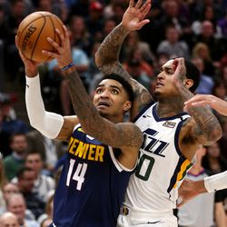 Denver Nuggets guard Gary Harris (14) puts up a shot with Utah Jazz guard Jordan Clarkson (00) defending as the Utah Jazz and the Denver Nuggets play an NBA basketball game at Vivint Arena in Salt Lake City on Wednesday, Feb. 5, 2020. Denver won 98-95, giving the Jazz their fifth straight loss.