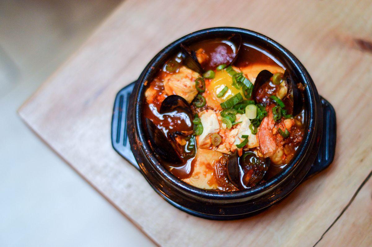 A dish of Soondubu, a spicy tofu stew with shellfish, served at Insa