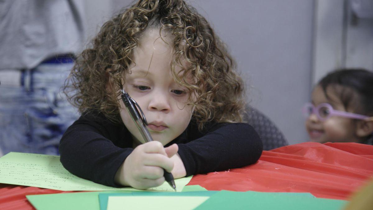 Dear Santa girl writing a letter