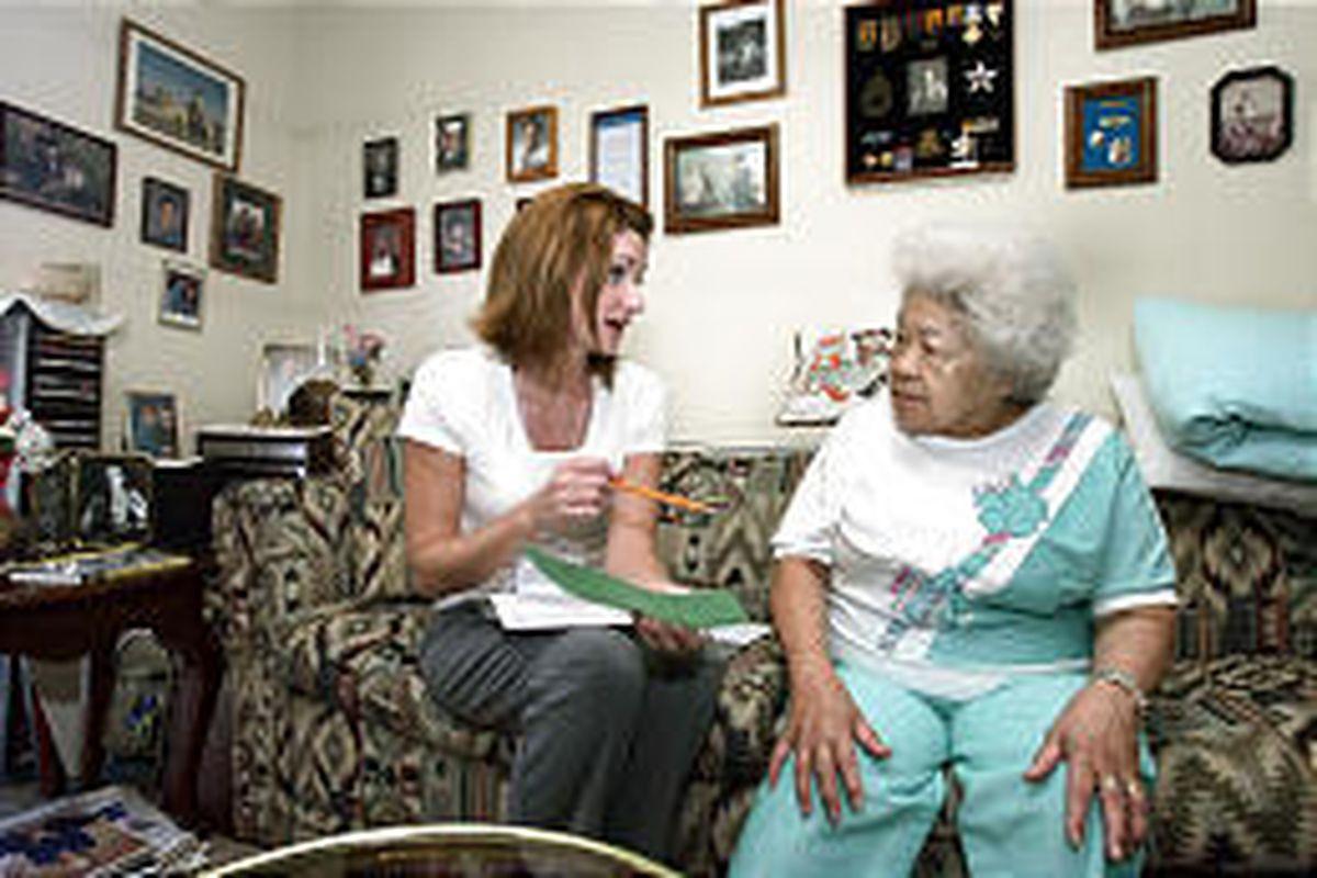 Heidi Drake, left, of Salt Lake County Aging Services talks with Johanna Van Dijks in her Salt Lake home about the Medicare prescription plan.