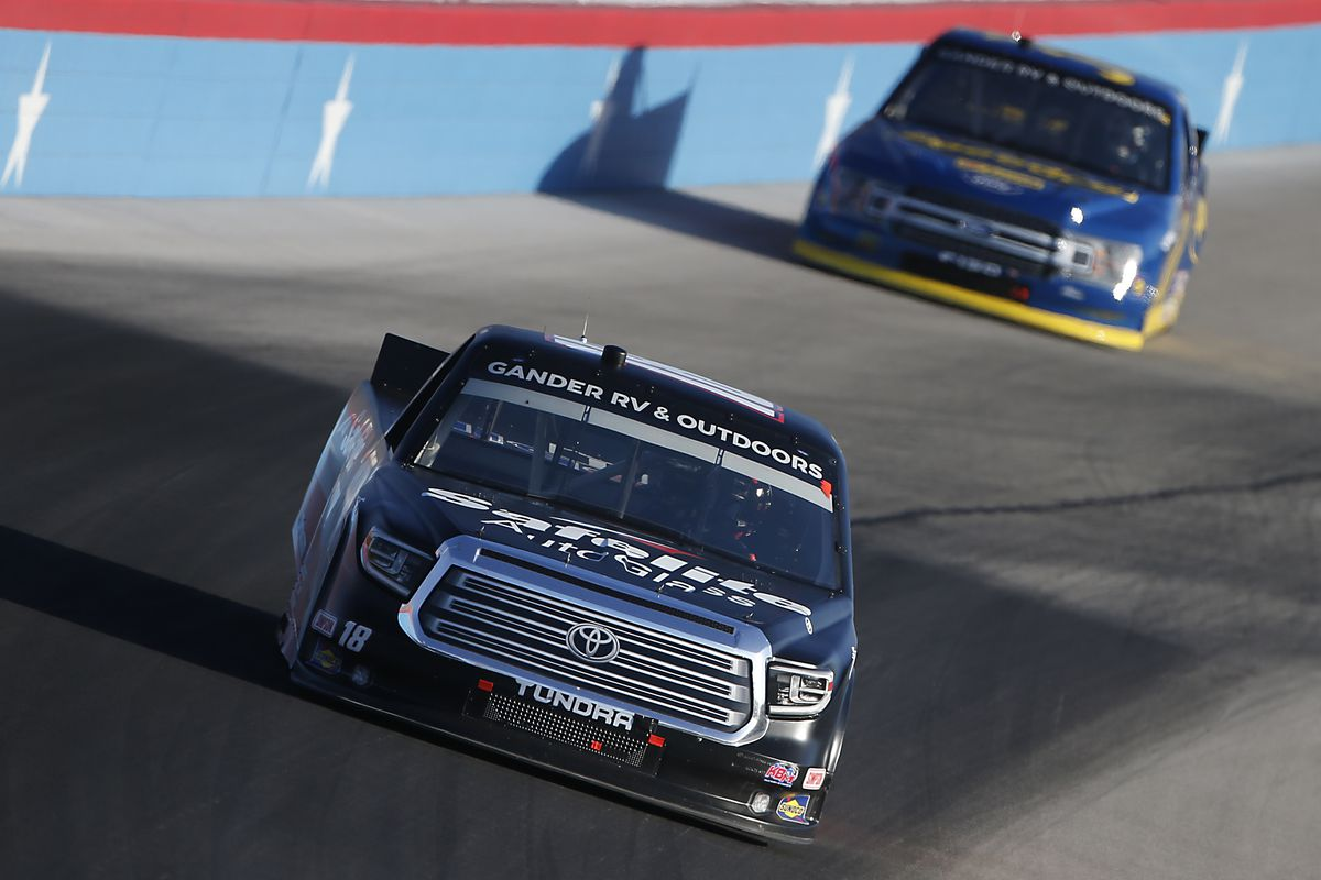 Christian Eckes, driver of the #18 Safelite AutoGlass Toyota, races during the NASCAR Gander RV & Outdoors Truck Series Vankor 350 at Texas Motor Speedway on July 18, 2020 in Fort Worth, Texas.
