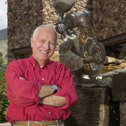 Artist James C. Christensen posing with his fountain in the Shops at Riverwoods in Provo, Utah, in May 2014. Christensen died on Sunday, Jan. 8, 2017, after a prolonged battle with cancer.