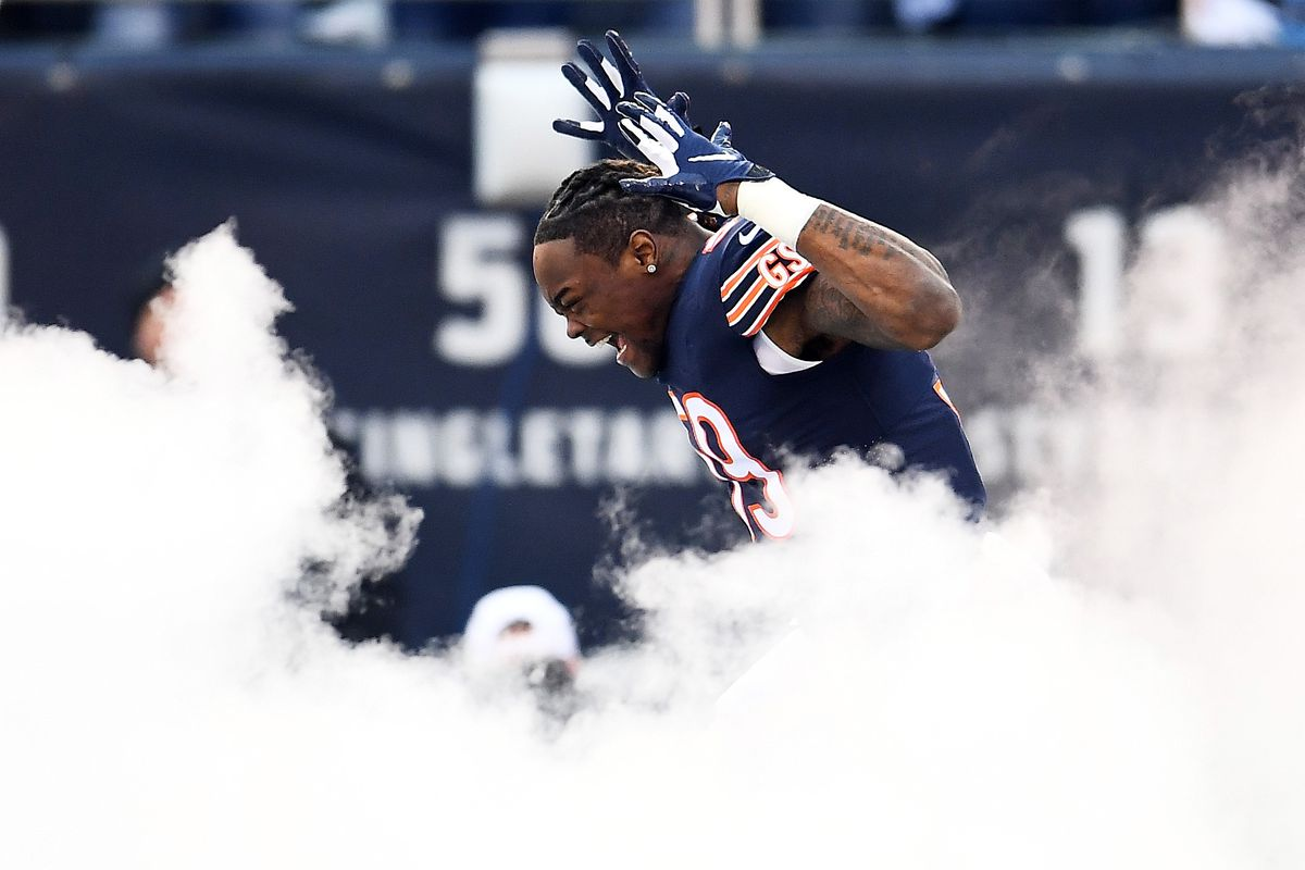 Danny Trevathan runs on the field before the Bears' playoff game in 2019.