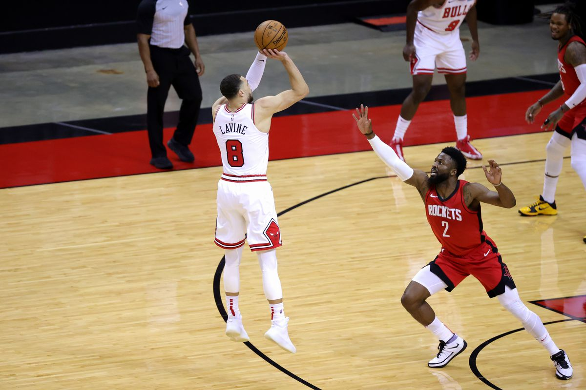 Zach LaVine of the Chicago Bulls shoots a basket ahead of David Nwaba of the Houston Rockets during the second quarter of a game at the Toyota Center on February 22, 2021 in Houston, Texas.