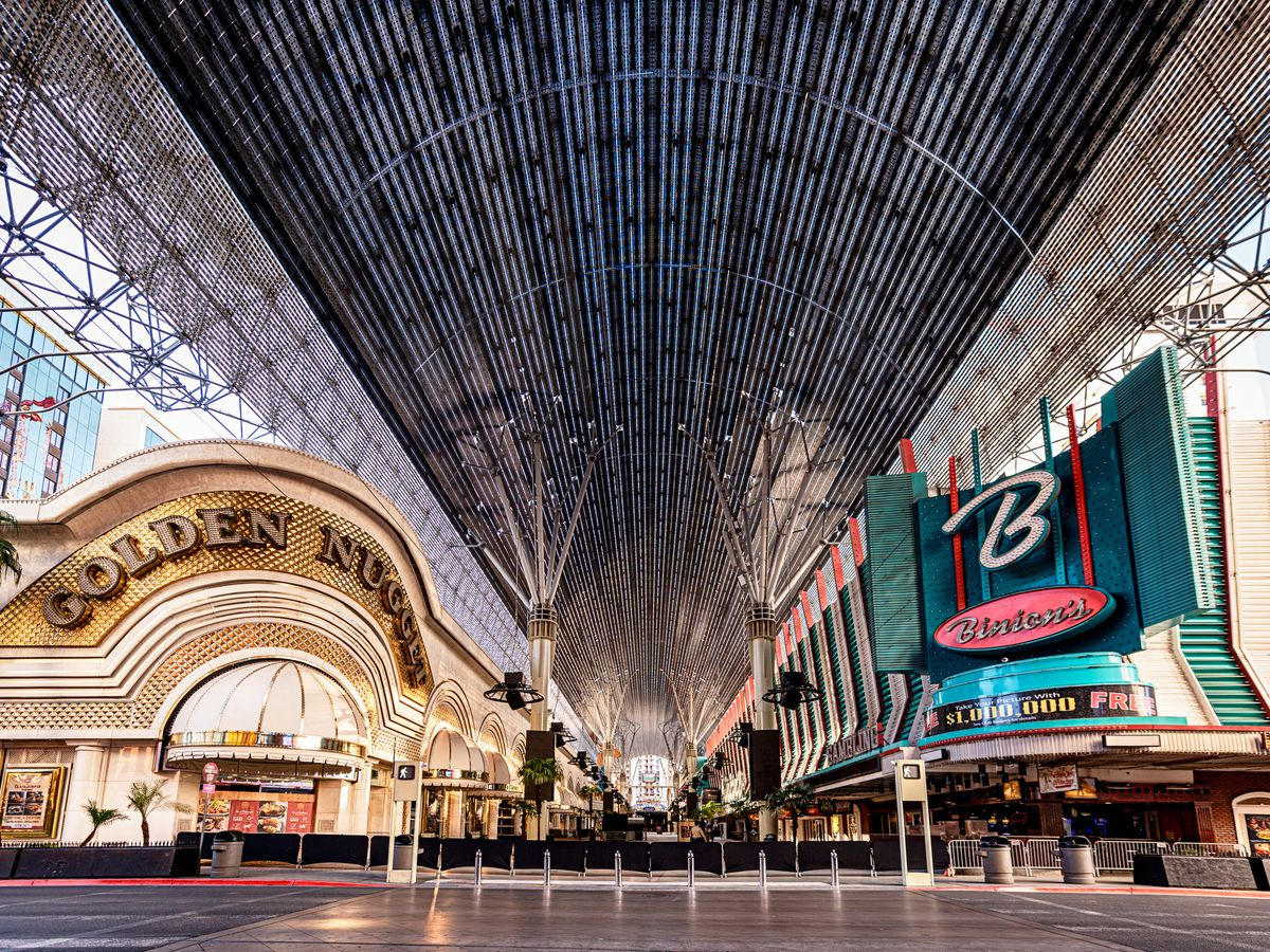 Hotels flank a pedestrian mall with a canopy overhead