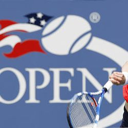 Kim Clijsters of Belgium serves to Viktoriya Kutuzova of Ukrain during the US Open tennis tournament in New York, Monday.