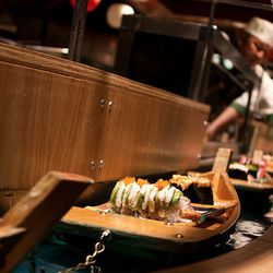 """Sushi boats at Isobune Sushi. <a href=""""http://www.flickr.com/photos/53418666@N08/7490470266/in/pool-520531@N21"""">Far Out City</a>"""