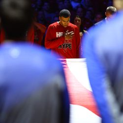 Traevon Jackson bows his head during the singing of the national anthem