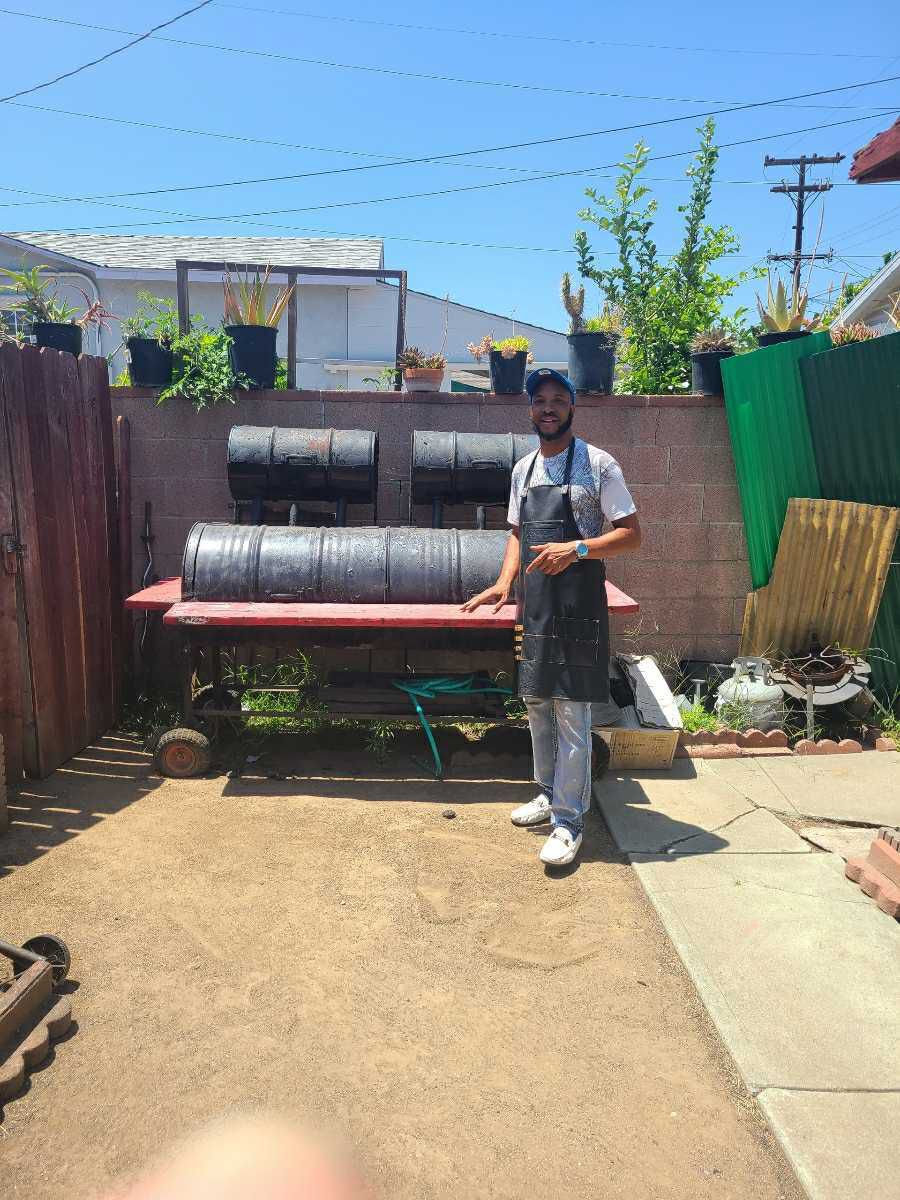 Dwight Morgan and his barrel barbecue pit in Los Angeles, California