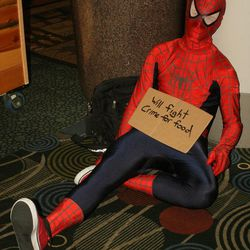 Kyle Anderson of Provo poses as Spiderman at Comic Con. With more than 50,000 tickets sold, Comic Con goers filled the convention halls to the max during the final day of the convention.