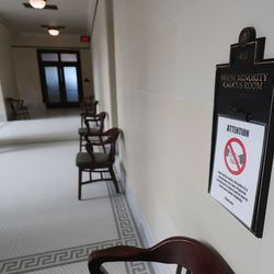 """""""No Handshaking"""" signs are pictured in the Capitol in Salt Lake City as the Utah Legislature opens the 2021 general session on Tuesday, Jan. 19, 2021."""