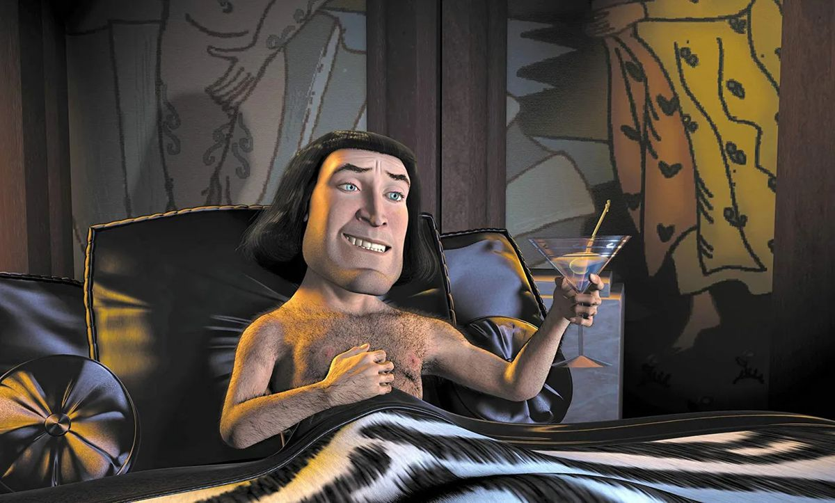 A bare-chested Farquaad lying in bed under a zebra-print blanket holding a martini