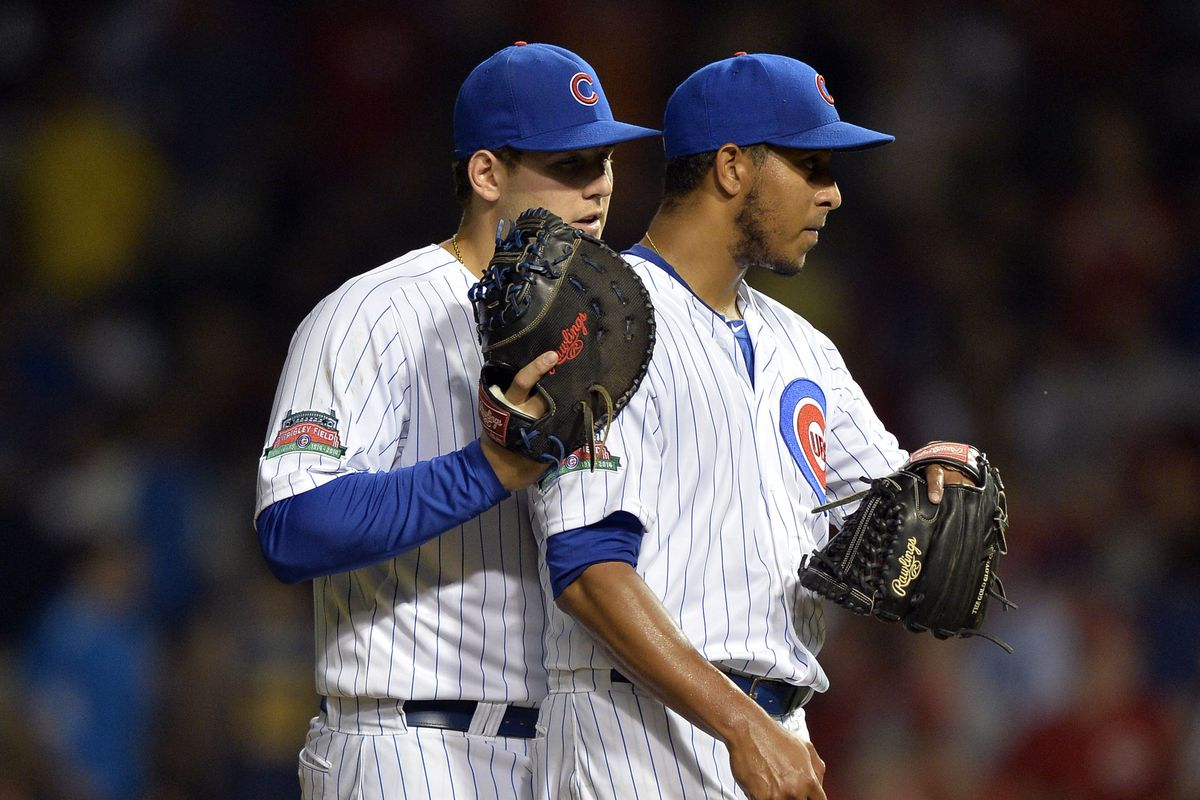 This was taken right after Devin Mesoraco's grand slam. What is Anthony Rizzo telling Hector Rondon?