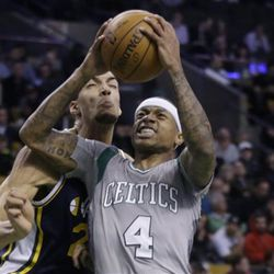 Boston Celtics guard Isaiah Thomas (4) goes up for a shot against Utah Jazz center Rudy Gobert (27) during the second half of an NBA basketball game in Boston, Wednesday, March 4, 2015. The Celtics won 85-84. (AP Photo/Elise Amendola)