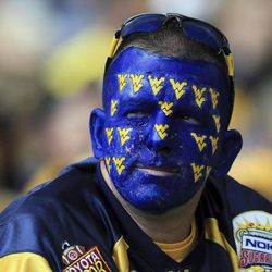A West Virginia fan looks on in the crowd during an NCAA college football game against Maryland in Morgantown, W.Va., Saturday, Sept. 22, 2012. WVU won 31-21.