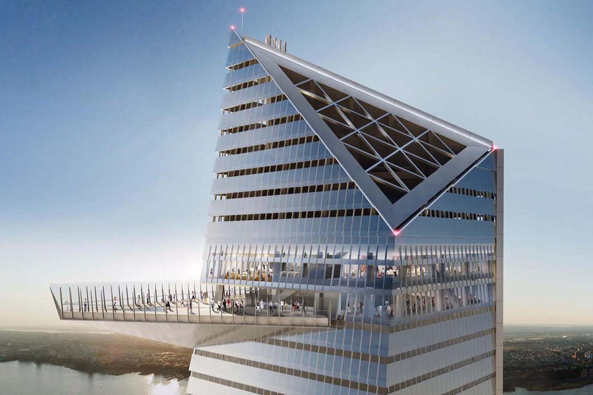 The top of a tall building with an observation deck. There are people standing on the observation deck.