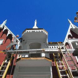 In this Sept. 8, 2012, photo, Chase Berryhill, left, and John Rodion, work on replacing roofing of the historic Strevell House in Pontiac, Ill. The Livingston County Historical Society is working on the landmark home and hopes to use the building as a local Lincoln museum.