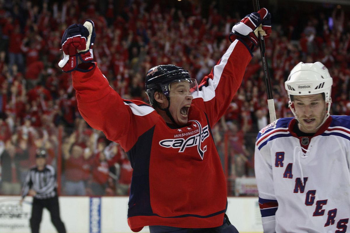 Alexander Semin of the Washington Capitals scores the game winning goal at 18:24 of overtime against the New York Rangers in Game One of the Eastern Conference Quarterfinals on April 13, 2011.
