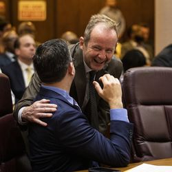 Ald. Tom Tunney (44th) laughs with Ald. Scott Waguespack (32nd) during Mayor Lori Lightfoot's first Chicago City Council meeting at City Hall, Wednesday, May 29, 2019.