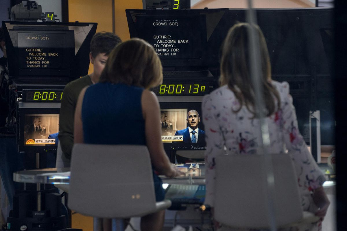 """Co-anchors Hoda Kotb, center left, and Savannah Guthrie, right, sit on the set during a news segment of """"Today"""" show Thursday, Nov. 30, 2017, in New York, in the wake of the firing of longtime """"Today"""" show anchor and host Matt Lauer, for """"inappropriate se"""