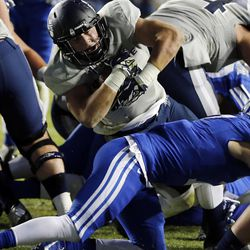 Nick Vigil (41) of the Utah State Aggies goes in for a touchdown against BYU during NCAA football in Provo, Friday, Oct. 3, 2014.