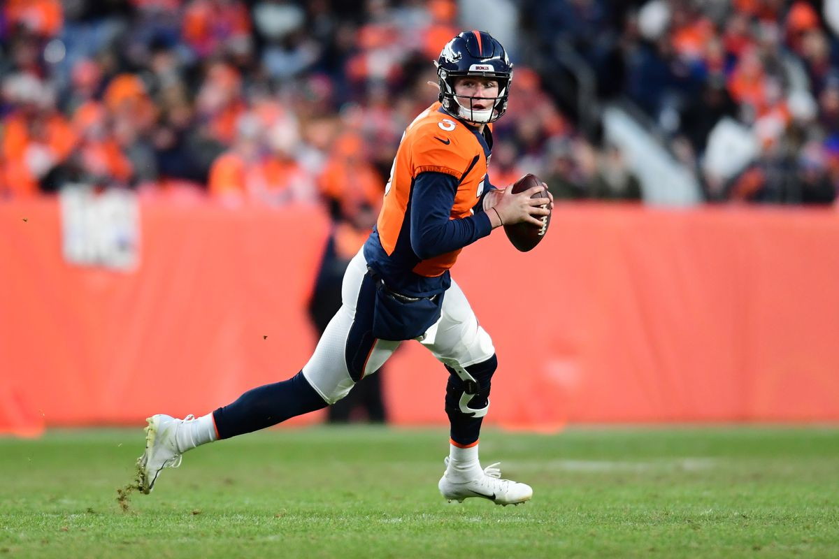 Denver Broncos quarterback Drew Lock scrambles with the ball in the second half against the Oakland Raiders at Empower Field at Mile High.
