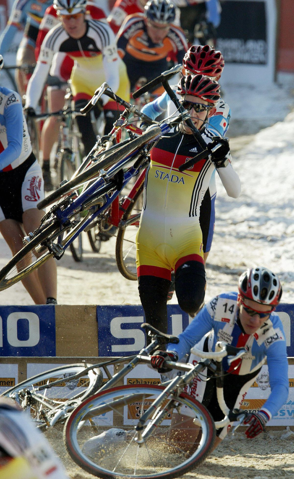 German Philipp Walsleben (C) jumps over