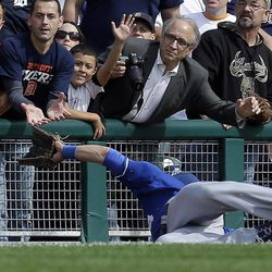 Kansas City Royals left fielder Alex Gordon makes a diving catch for an out on a Detroit Tigers' Andy Dirks fly ball in foul territory in the sixth inning of a baseball game in Detroit, Thursday, Sept. 27, 2012.