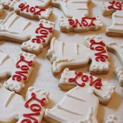 """Provide these <a href=""""http://www.whippedbakeshop.com/product/love-and-liberty-cookie-favors"""">Liberty Bell Cookie Favors</a> ($4.50/ea at Fishtown's Whipped Bakeshop) for the eggs-and-butter set."""
